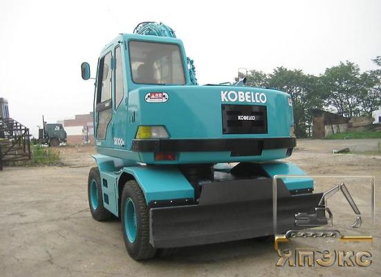 Экскаватор на колесном ходу  Kobelco SK100W зеленый - ЯпЭкс - Реализация Японской спецтехники на российском рынке. Покупка с аукционов Японии под Ваш заказ.