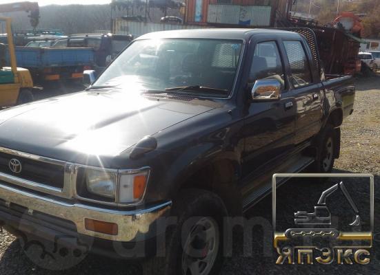 Toyota Hilux Pick Up Серый - ЯпЭкс - Реализация Японской спецтехники на российском рынке. Покупка с аукционов Японии под Ваш заказ.