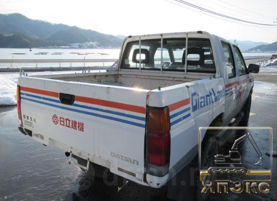 Nissan Datsun белый - ЯпЭкс - Реализация Японской спецтехники на российском рынке. Покупка с аукционов Японии под Ваш заказ.